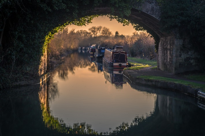 A view of canal boats tied up for winter
