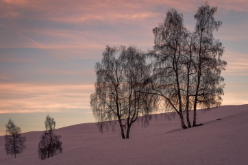 Subdued sunrise: A view of a very pastel-coloured sunrise in the Swiss alps.