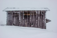 I am extremely cold: A view of a frozen, snow-covered barn in the Swiss Alps.