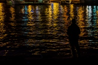 Just fishing: Harbour lights with a lone fisherman