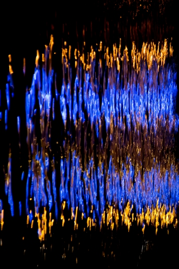 Reflections in the river Rhine at night