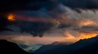 Mordor - Eye of Sauron?: A view of a sunset after a storm, with a shaft of sunlight, through the mountains, hitting a cloud