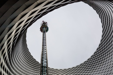 """All the fun of the fair: A view of the Basel autumn fair with a free fall tower positioned in the exhibition centre hole """"Fenster zum Himmel"""" (""""window to heaven"""")."""